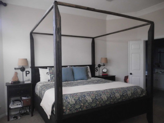 this is an example of our canopy bed with removable canopy frame the bed shown is a kingsize with optional black stain